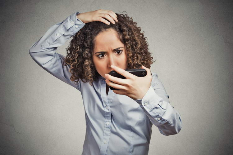 shocked funny looking young woman surprised she is losing hair